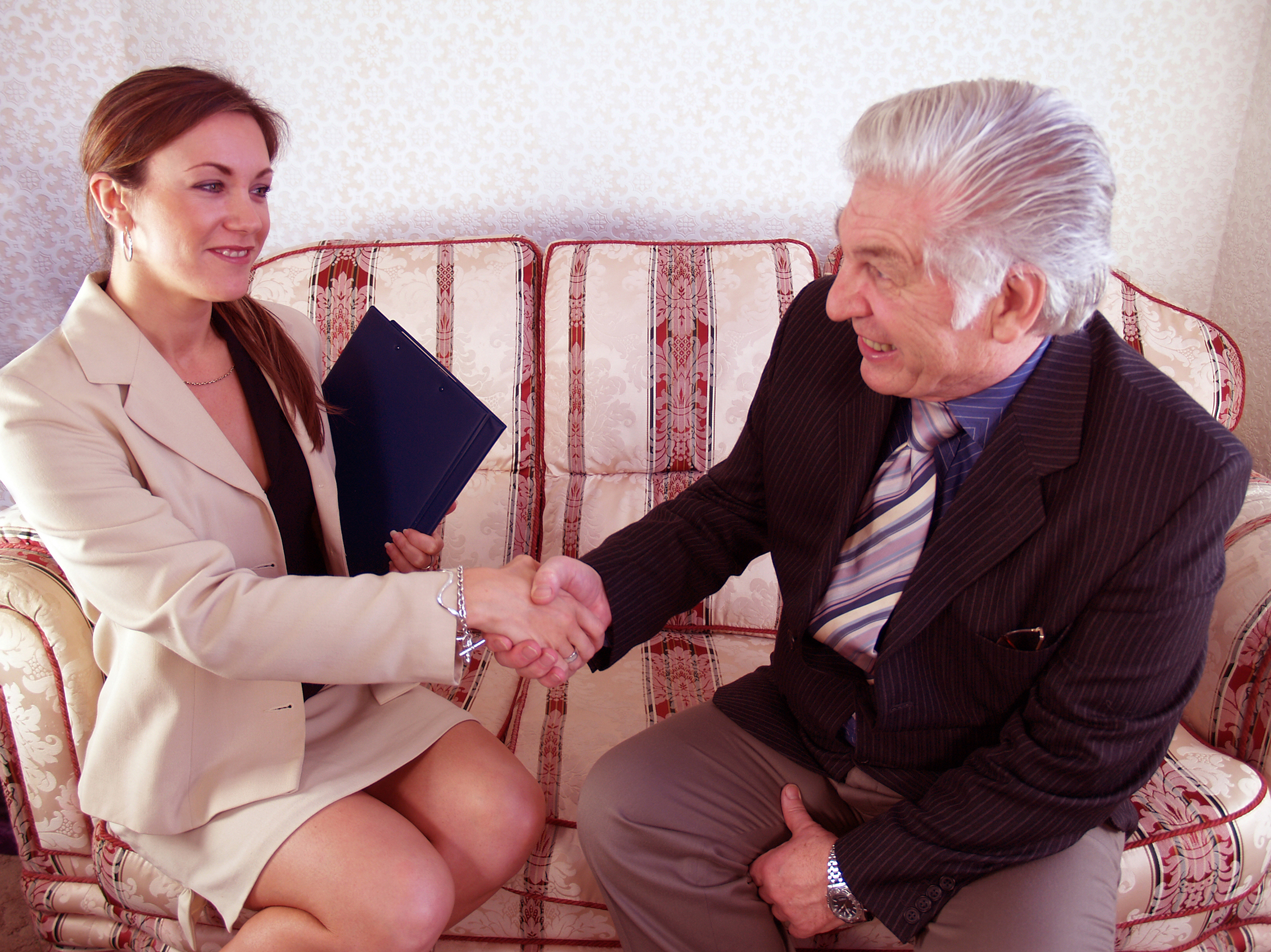 Shaking on concluding a successful deal couple