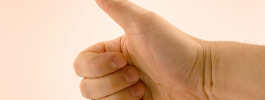A thumbs up on white background